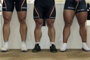 The leg muscles of German gold medallists Rene Enders, Robert Foerstemann and Stefan Nimke, from left to right, are seen during the podium ceremony of the men team sprint at the European Championships Track Cycling in Apeldoorn, eastern Netherlands, Friday Oct. 21, 2011. (AP Photo/Peter Dejong)